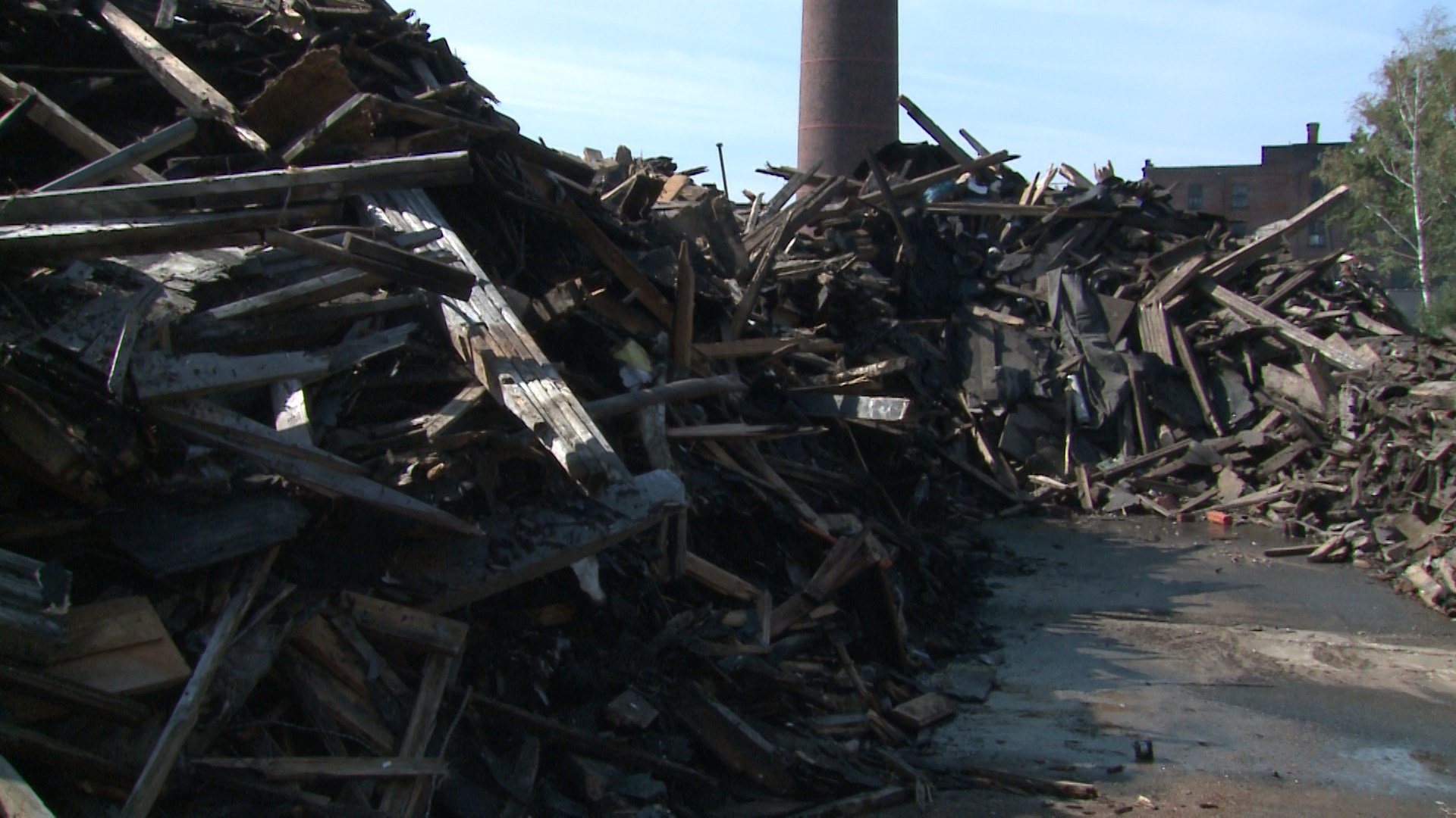 Charred wood pile, East 16th Street