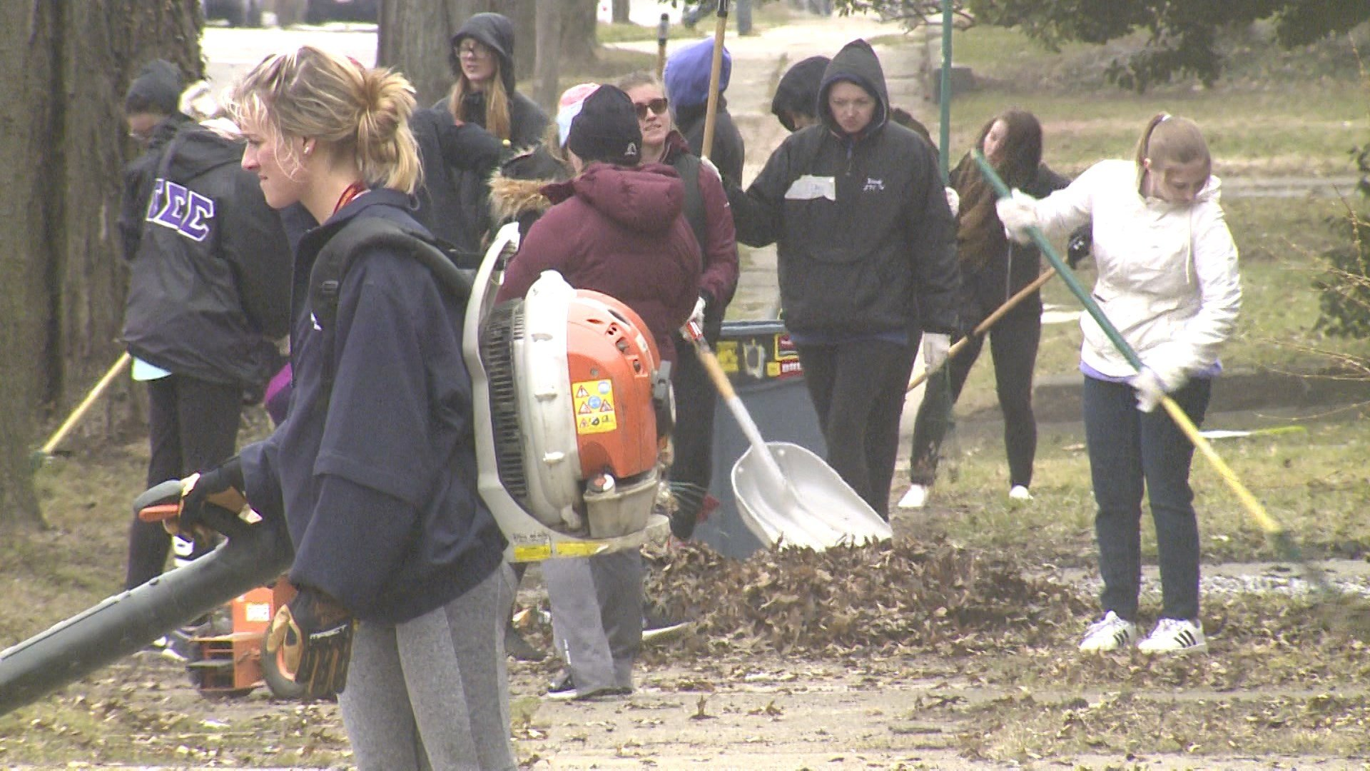 The Gannon University community cleans up the neighborhood near West 8th and Popular in Erie.