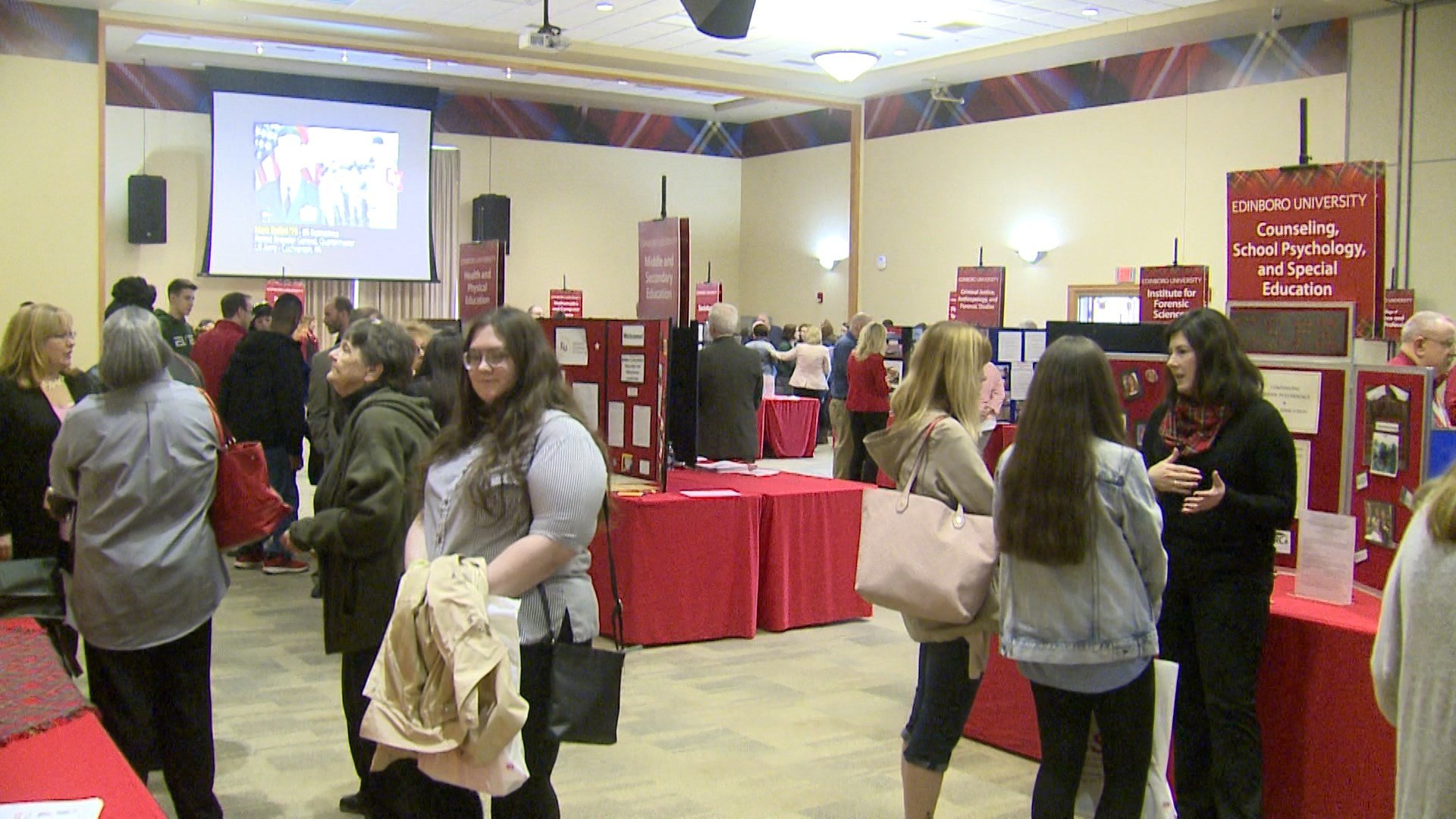 Students check out different stations at the Frank G. Pogue Center during Edinboro University's spring open house.