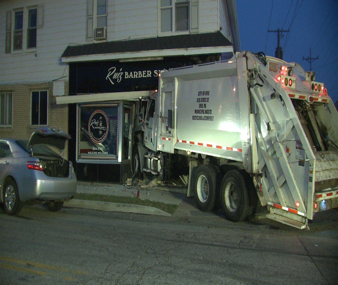 Video Shows Erie Garbage Truck Crash Into Barber Shop