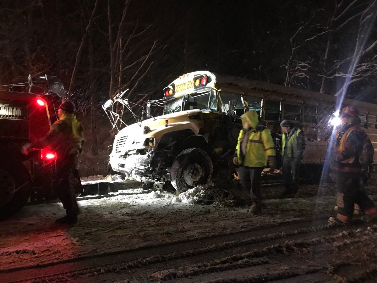 the bus was heading west around 415 pm when a semi traveling east started to fishtail and collided into the front end of the school bus
