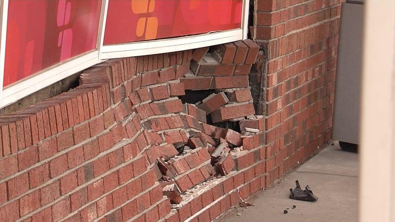 weny news car drives into building temporarily closes cvs