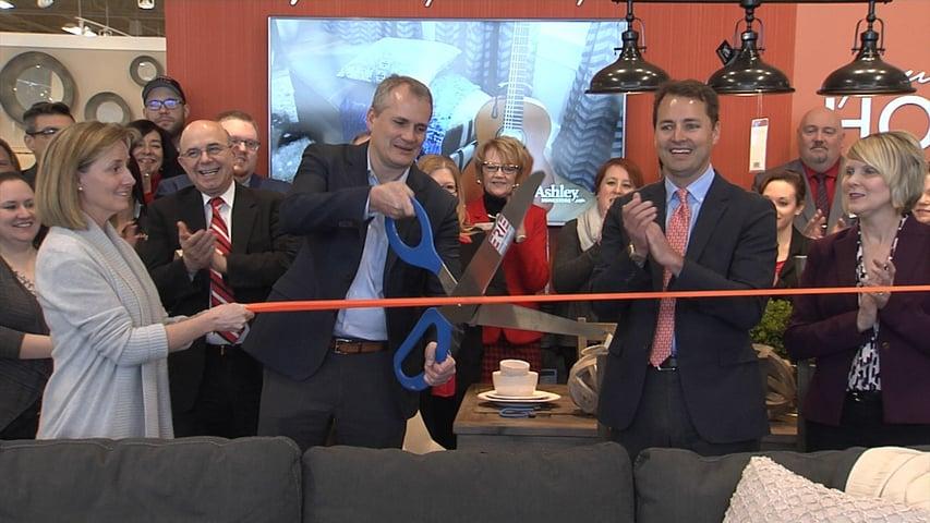 John V Schultz Cuts Ribbon On New, John V Schultz Furniture