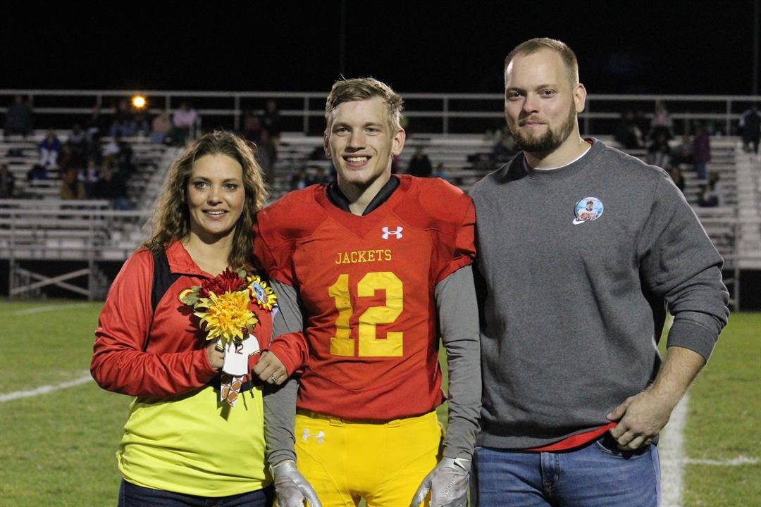 Dustin Roesch celebrates senior night